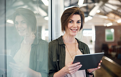 Buy stock photo Portrait of an attractive young businesswoman using a digital tablet in an office