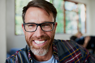 Buy stock photo Portrait shot of a handsome mature man at home