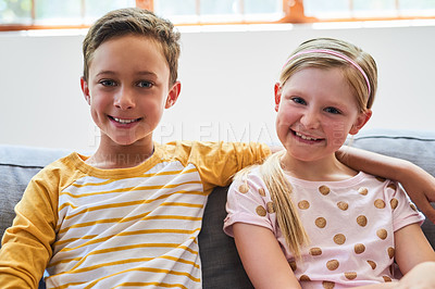 Buy stock photo Portrait of an adorable brother and sister chilling on the sofa in the living room at home