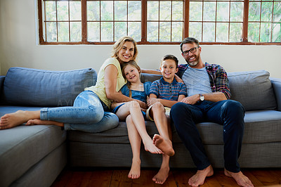 Buy stock photo Shot of an affectionate family on the sofa in the living room at home