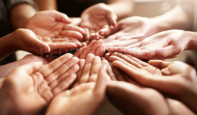 Buy stock photo Closeup shot of a group of people standing together with their hands cupped