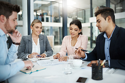 Buy stock photo Cropped shot of a group of businesspeople sitting in their office boardroom during a meeting