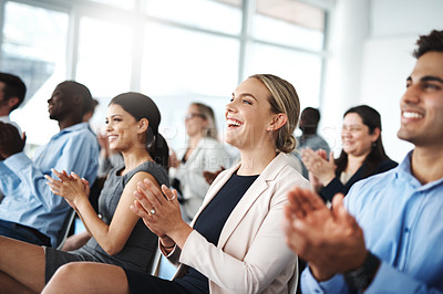 Buy stock photo Cropped shot of a group of businesspeople applauding while sitting in a lecture room during a seminar