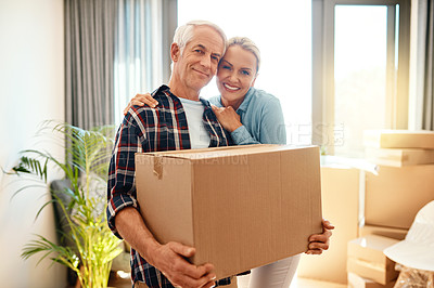 Buy stock photo Portrait of a happy mature couple carrying boxes on moving day