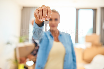 Buy stock photo Closeup shot of a woman holding the key to her new home
