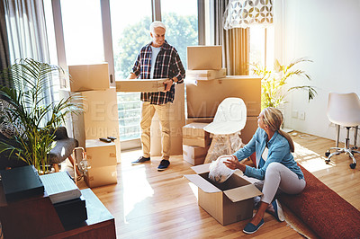 Buy stock photo Shot of a mature couple packing boxes on moving day