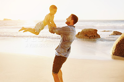Buy stock photo Shot of a father bonding with his little son at the beach