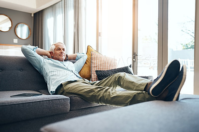 Buy stock photo Shot of a senior man relaxing on the sofa at home
