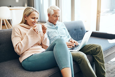 Buy stock photo Cropped shot of mature couple using a laptop on the sofa at home