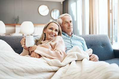 Buy stock photo Cropped shot of a mature couple relaxing on the sofa at  home