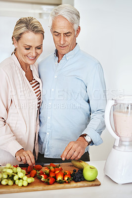 Buy stock photo Cropped shot of an affectionate mature couple preparing a healthy snack at home