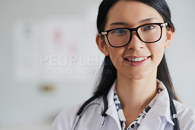 Buy stock photo Cropped portrait of a young female doctor standing in her office in the hospital
