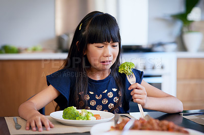 Buy stock photo Shot of a little girl refusing to eat her broccoli