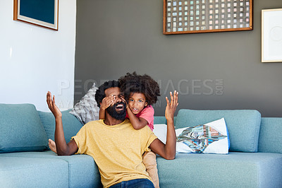 Buy stock photo Shot of a cheerful little boy holding his father's eyes closed from behind as a surprise at home