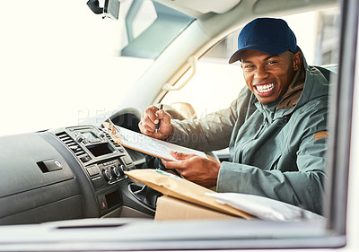 Buy stock photo Portait of a courier writing on a clipboard while sitting in a delivery van