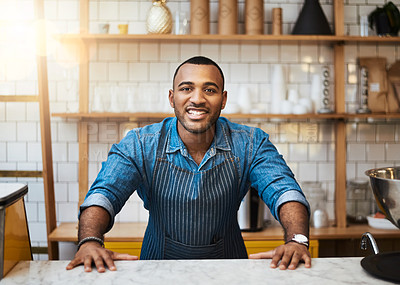 Buy stock photo Cropped portrait of a handsome young man standing in his coffee shop