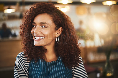 Buy stock photo Cropped shot of an attractive young woman standing in her coffee shop