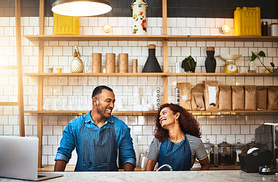 Buy stock photo Cropped shot of an affectionate young couple standing in their coffee shop
