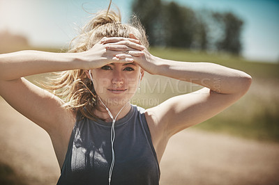 Buy stock photo Portrait of a young woman taking a break while out for a run