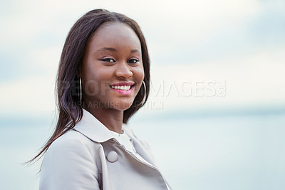 Buy stock photo Portrait of an attractive young woman spending time outdoors