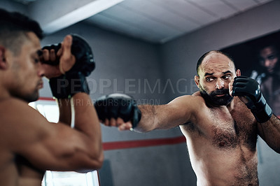 Buy stock photo Cropped shot of two male fighters training at the gym