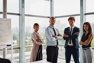 Buy stock photo Cropped shot of corporate businesspeople standing with their arms crossed in the office