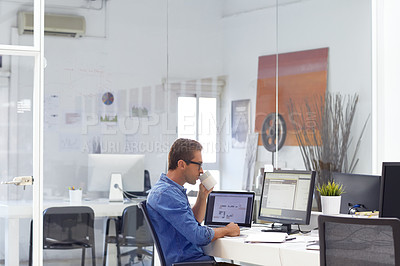 Buy stock photo Shot of a businessman working on his computer