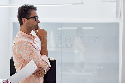 Buy stock photo Cropped shot of a businessman standing in an office