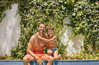 Buy stock photo Portrait of a father and his son enjoying a day by the swimming pool