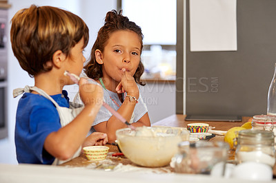 Buy stock photo Cropped shot of a brother and sister tasting batter in the kitchen at home