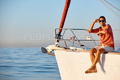 Buy stock photo Portrait of a young man going for an ocean cruise on a boat