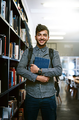 Buy stock photo Portrait of a happy young man carrying books in a library at college