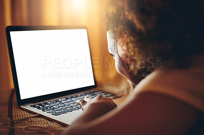 Buy stock photo Rearview shot of a young woman using a laptop at home