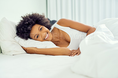 Buy stock photo Cropped shot of an attractive young woman lying in bed at home