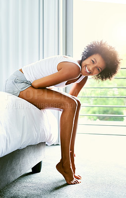 Buy stock photo Shot of an attractive young woman in her bedroom at home