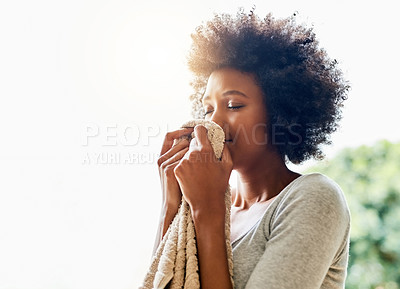 Buy stock photo Cropped shot of an attractive young woman smelling clean laundry at home