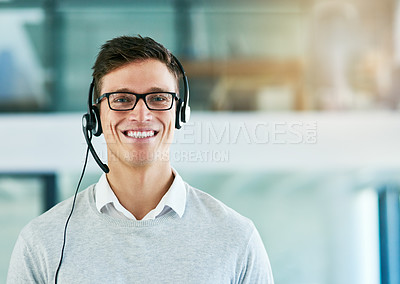 Buy stock photo Portrait of a young call center agent working in an office