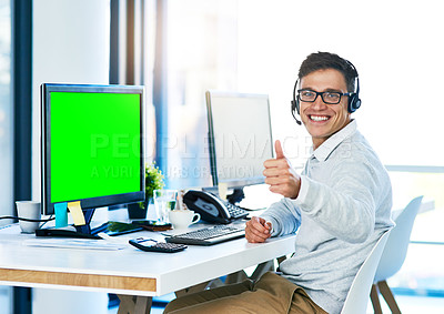 Buy stock photo Portrait of a young call center agent showing thumbs up while working in an office