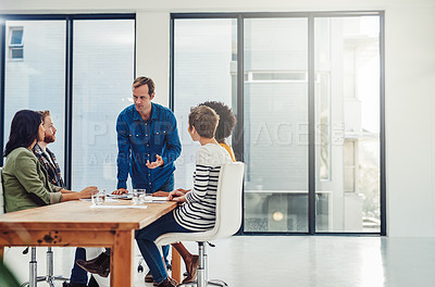 Buy stock photo Shot of a group of creative professionals having a meeting in a modern office