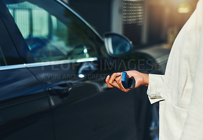 Buy stock photo Shot of an unrecognizable businesswoman holding keys and about to open her car outside during the day