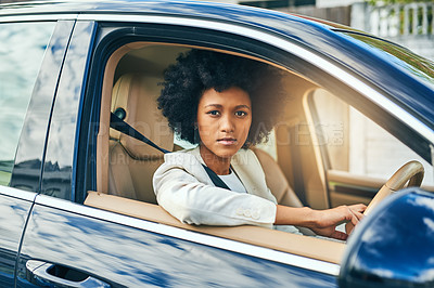 Buy stock photo Portrait of a confident young businesswoman on her way to work while driving in a car during the day