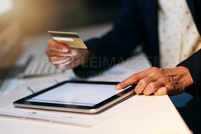 Buy stock photo Closeup shot of an unrecognizable businesswoman making an online purchase using a credit card and digital tablet at the office