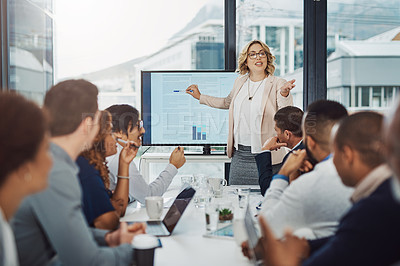 Buy stock photo Cropped shot of an attractive businesswoman giving a presentation in the boardroom