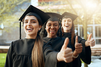 Buy stock photo Portrait of a group of young women showing thumbs up on graduation day