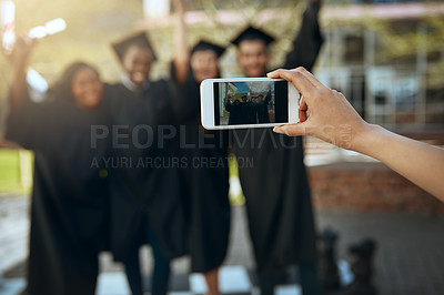Buy stock photo Shot of a group of students taking pictures with a mobile phone on graduation day