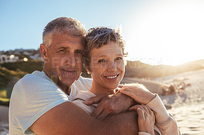 Buy stock photo Shot of an affectionate mature couple enjoying a day at the beach