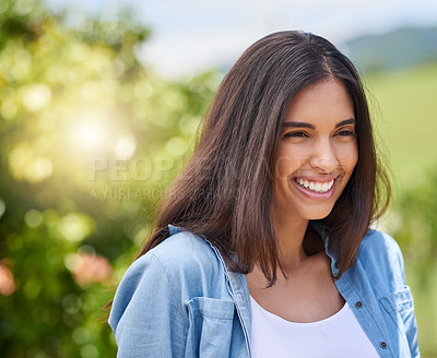 Buy stock photo Cropped shot of an attractive young woman standing outdoors