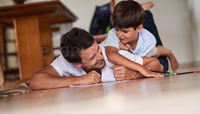 Buy stock photo Full length shot of a father playing with son on the floor at home