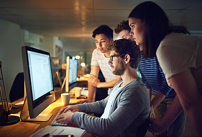 Buy stock photo Shot of a group of designers working late in an office