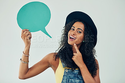 Buy stock photo Studio shot of an attractive young woman holding a speech bubble against a grey background